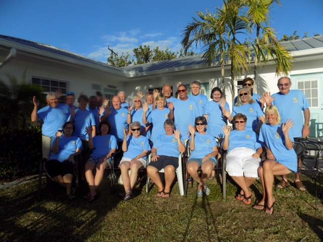 A group of 24 guest with matching blue t-shirts.
