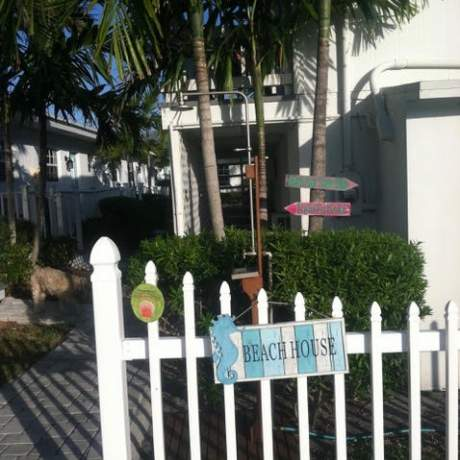 Walkway with picket fence and Beach House sign